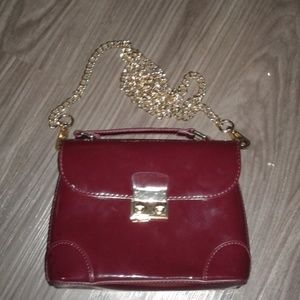 Burgundy with gold chain purse
